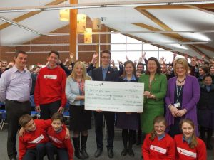 Presenting the cheque to The Red Cross