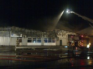The charred front face of the building