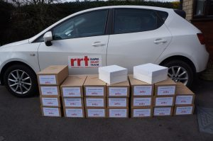 RRT preparing to deliver the cakes to the various stations along the routes.