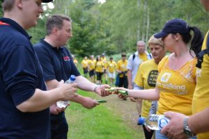RRT Handing out cereal bars and water.