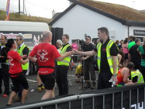 RRT handing out water at the finish line