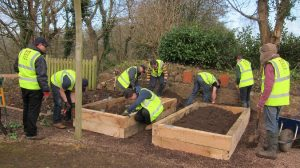 Filling the new planters with soil