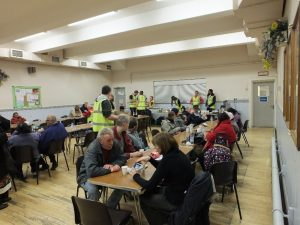 Some of the evacuated residents at Belgrave Community Centre enjoying the refreshments